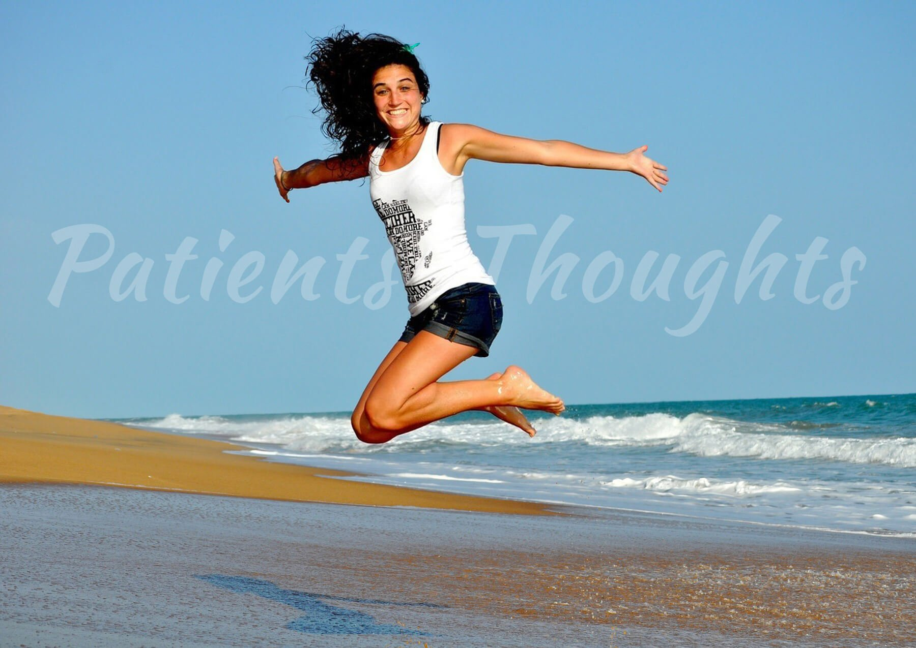 happy woman jumping on a beach